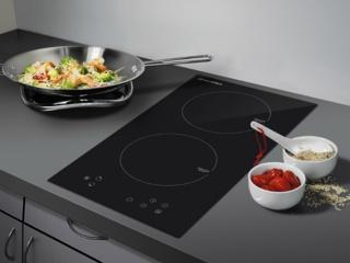 Варочные поверхности в интерьере современной кухни